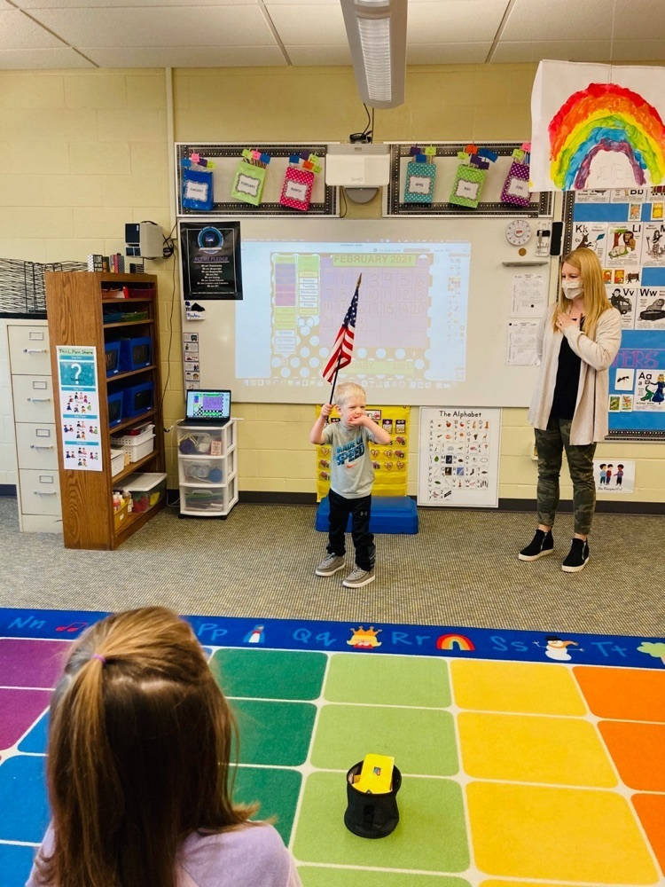 PreK students starting day with flag salute!